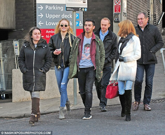 Photo of Joe and Sophie with family in London